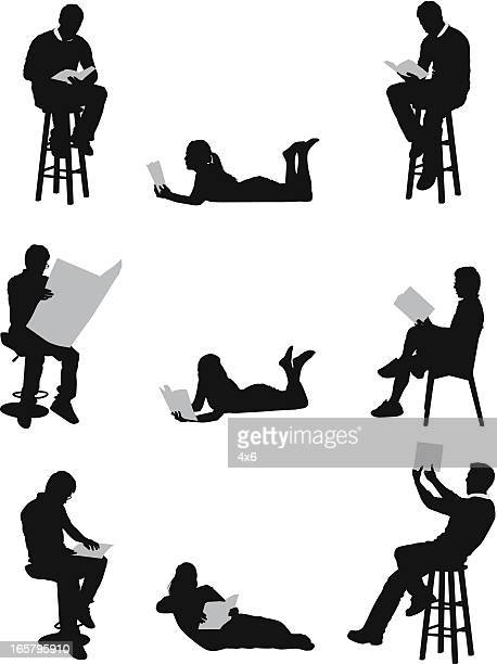 men and women reading books or newspaper - lying on front stock illustrations, clip art, cartoons, & icons