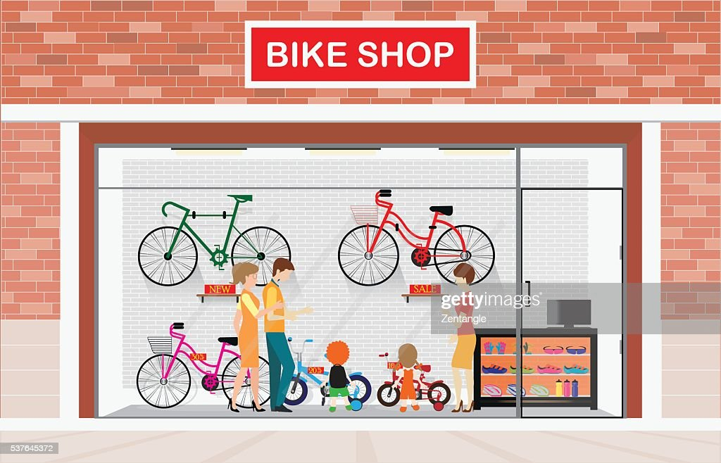 Men and women with kids buying bicycle.