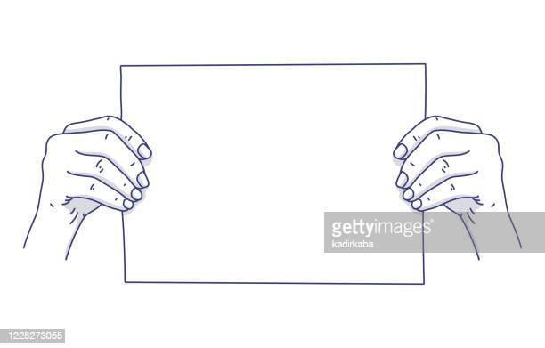 men hand holding blank paper sheet or letter paper on background - gesturing stock illustrations