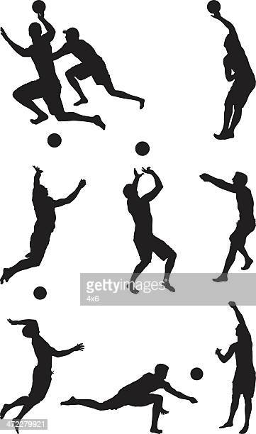 Men playing volleyball