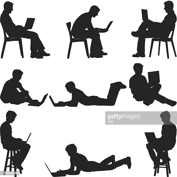 men sitting at home using laptops - lying on front stock illustrations, clip art, cartoons, & icons