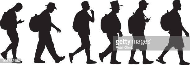 men walking with backpacks silhouettes - mature adult stock illustrations