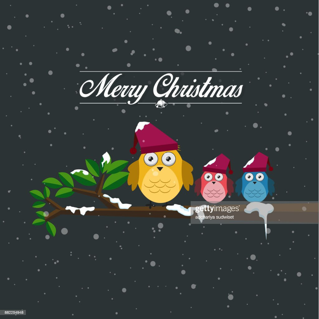 merry christmas and happy new year card and the family birds perched on a branch