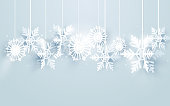 Merry Christmas and Happy new year with snowflakes hanging on white background