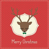 Merry Christmas card with cute deer with bow.
