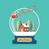 Merry christmas glass ball with Santa sleigh and winter house