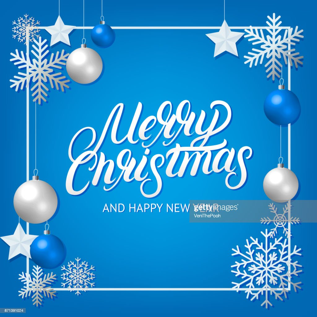 Merry Christmas hand written lettering with silver decoration ornament.