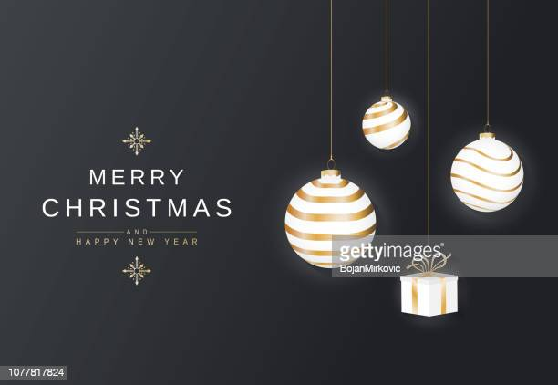 merry christmas hanging balls and gift. poster, card or background. golden lettering. vector illustration. - {{asset.href}} stock illustrations