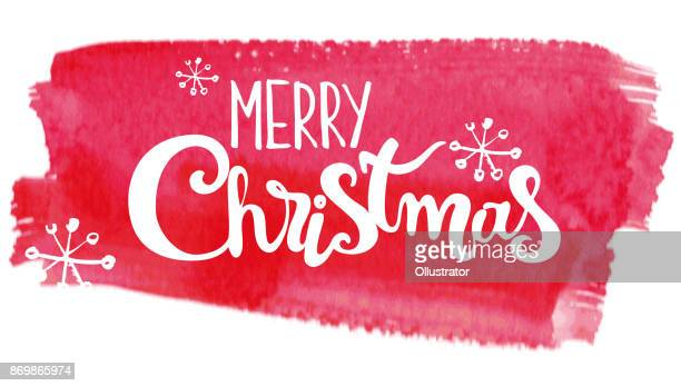Merry Christmas lettering on abstract watercolor pink background