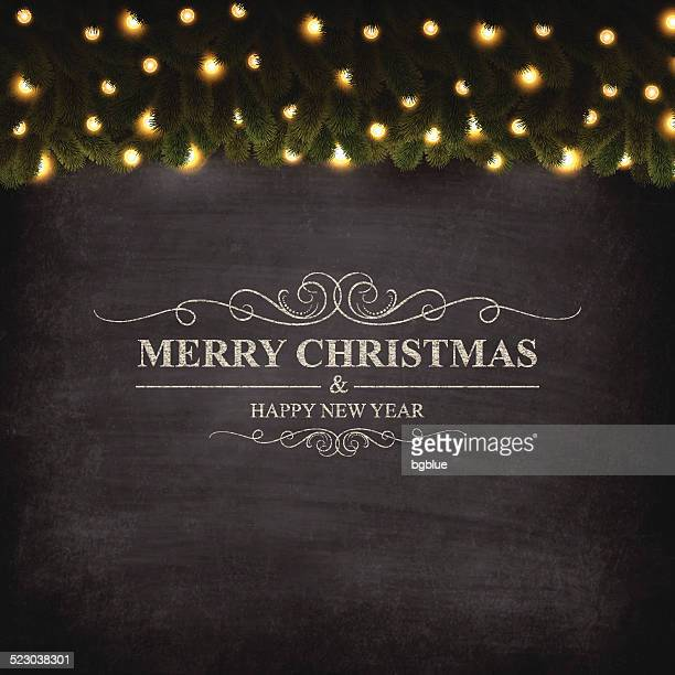 Merry Christmas lettering on Chalkboard with bright garland