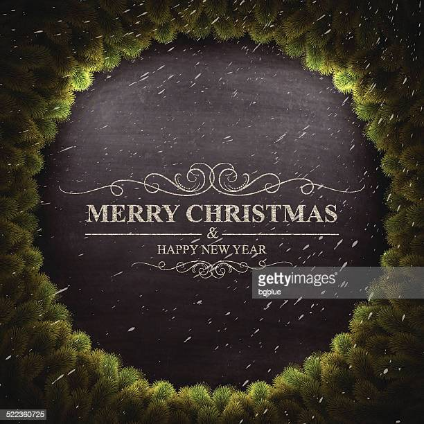 Merry Christmas lettering on Chalkboard with Christmas wreath and snow