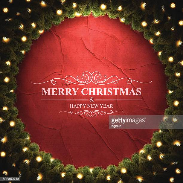 Merry Christmas lettering on crumpled paper with bright Christmas wreath