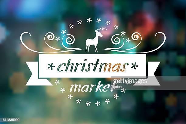 merry christmas market vintage badge on blurred lights