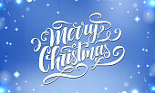 Merry Christmas ornate vector lettering. Handwritten card. Modern calligraphy. Holiday hand lettered design template for poster, flyer, banner. Abstract blue background with shiny sparkles.