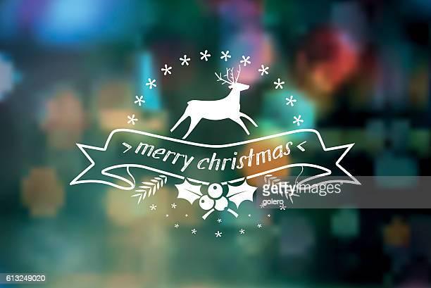 merry christmas  vintage badge on blurred lights