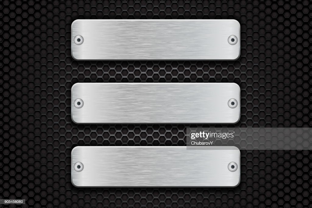 Metal brushed plate on perforated dark steel background