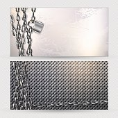 Metal chain and padlock on a gray metal banners