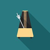 Metronome icon with long shadow.