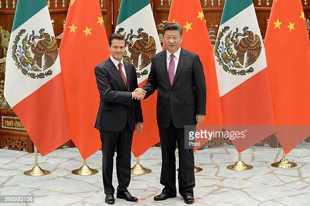 Mexico's President Enrique Pena Nieto shakes hands with Chinese President Xi Jinping at the West Lake State Guest House on September 4 2016 in...