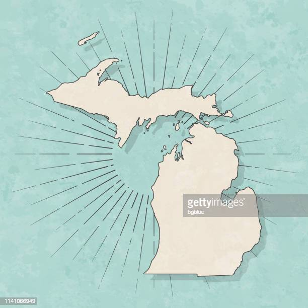 michigan map in retro vintage style - old textured paper - michigan stock illustrations