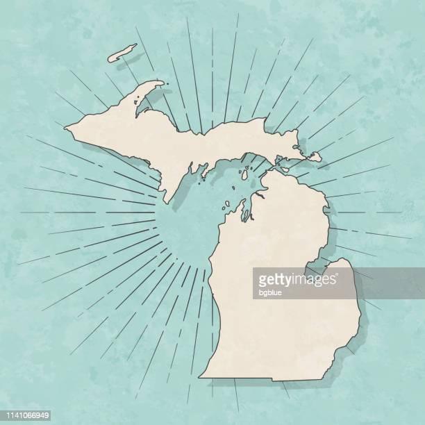 ilustraciones, imágenes clip art, dibujos animados e iconos de stock de mapa de michigan en estilo retro vintage-papel texturizado antiguo - michigan