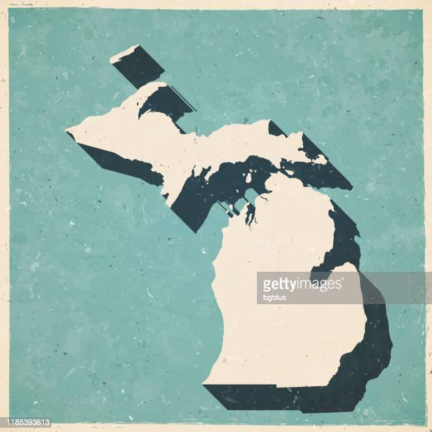 michigan map in retro vintage style - old textured paper - detroit michigan map stock illustrations