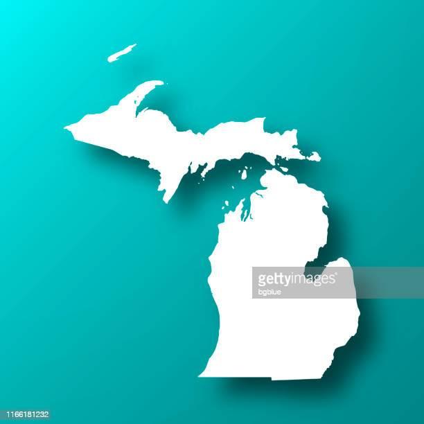 ilustraciones, imágenes clip art, dibujos animados e iconos de stock de mapa de michigan en el fondo verde azul con sombra - michigan