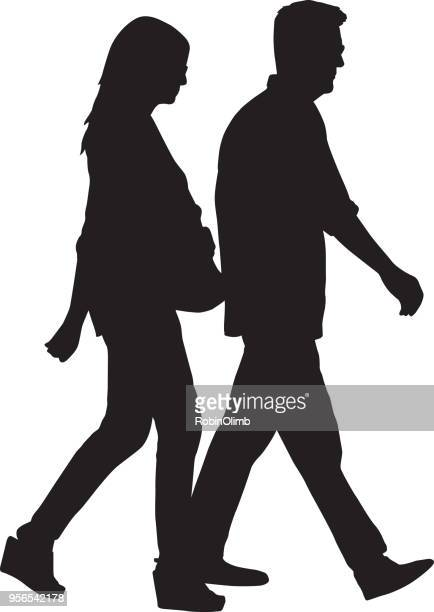 middle aged couple walking silhouette - mature adult stock illustrations