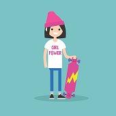 Millennial skater girl wearing t-shirt with Girl power sign