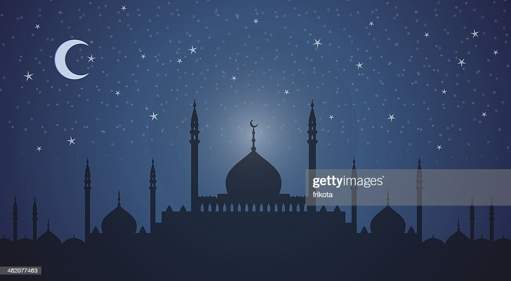Minarets and domes at night