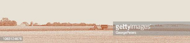 minnesota autumn landscape with tractor harvesting crops - sepia toned stock illustrations