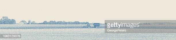 Minnesota Autumn Landscape with Tractor harvesting crops