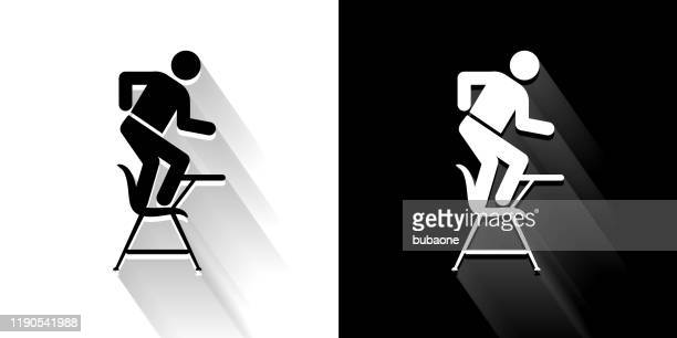 misbehaving on school desk black and white icon with long shadow - naughty america stock illustrations