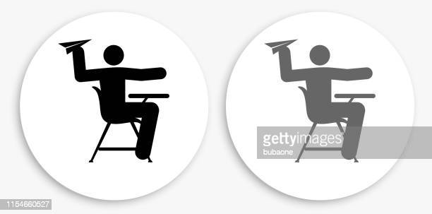 misbehaving on school desk black and white round icon - naughty america stock illustrations, clip art, cartoons, & icons