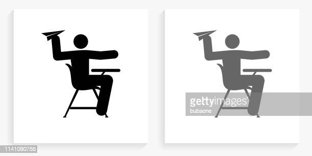 misbehaving on school desk black and white square icon - naughty america stock illustrations, clip art, cartoons, & icons