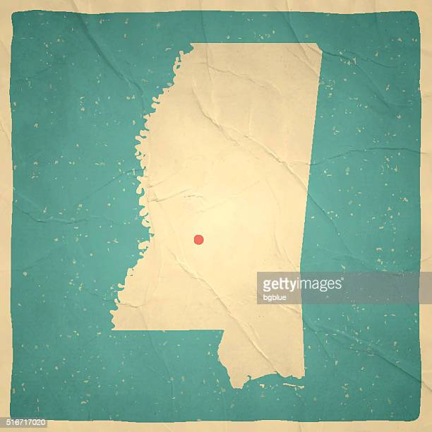 mississippi map on old paper - vintage texture - mississippi stock illustrations, clip art, cartoons, & icons