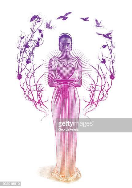 mixed race romance goddess holding glowing heart. - spirituality stock illustrations