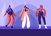 Model Girls in Fashioned Haute Couture Clothing Walking on Runway Demonstrating New Collection of Apparel. Pret-a-Porte, Fashion Show on Catwalk. Female Characters Cartoon Flat Vector Illustration