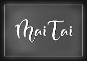 Modern calligraphy lettering of Mai Tai in white on chalkboard background with white frame