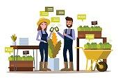 Modern farmer using smartphone  in greenhouse.