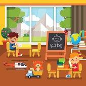 Modern kindergarten playroom. Kids playing