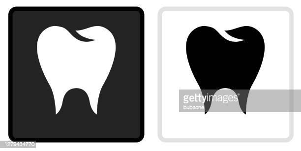 molar icon on  black button with white rollover - molar stock illustrations