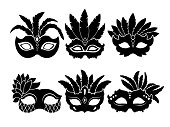 Monochrome black illustrations of carnival masks isolated on white background