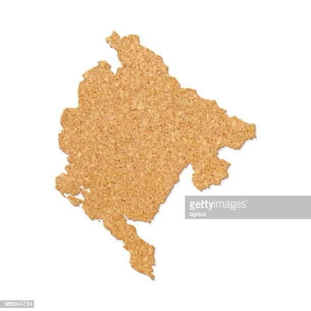 montenegro landkarte in cork tisch-struktur auf weißem hintergrund - montenegro stock-grafiken, -clipart, -cartoons und -symbole