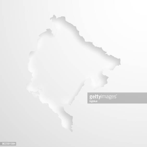 montenegro landkarte mit geprägtem papier wirkung auf leeren hintergrund - montenegro stock-grafiken, -clipart, -cartoons und -symbole
