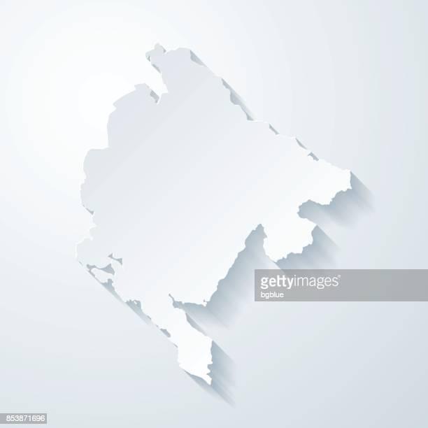 montenegro landkarte mit papier geschnitten wirkung auf leeren hintergrund - montenegro stock-grafiken, -clipart, -cartoons und -symbole