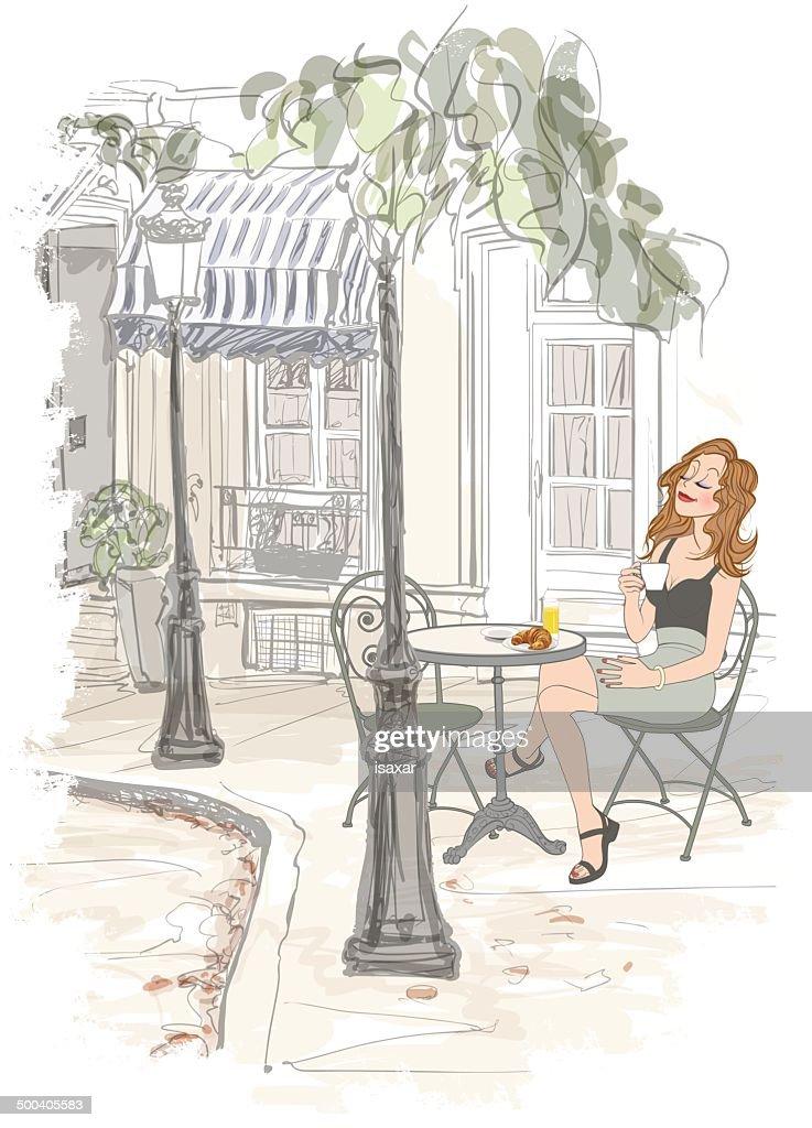 Montmarte in Paris - woman on holiday having breakfast