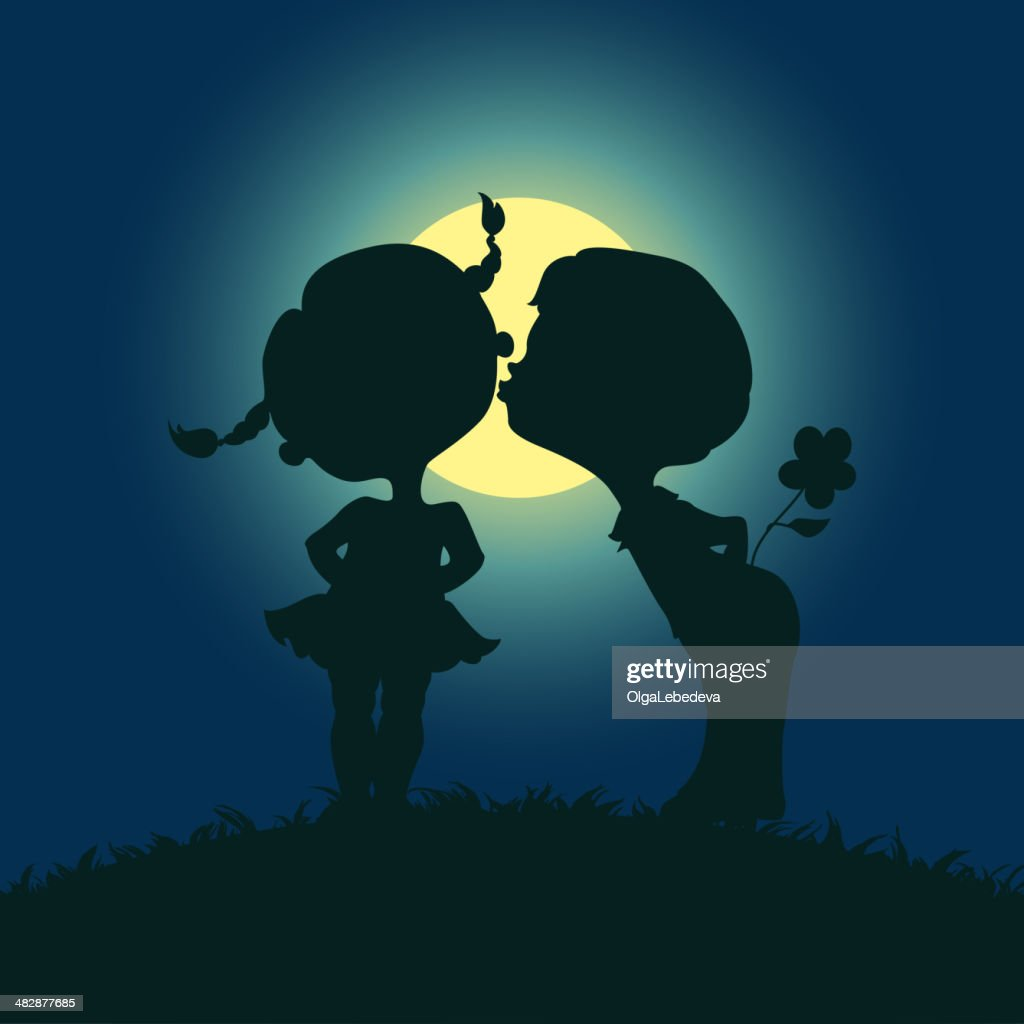 Moonlight silhouettes of kissing boy and girl