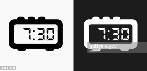 Morning Alarm Clock Icon on Black and White Vector Backgrounds