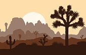 Morning landscape with Joshua tree and mountains over sunset.